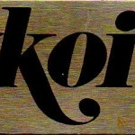 A metal tag from an Auditron Radio programmed specifically to 93.7 FM WKOI Pittsburgh.
